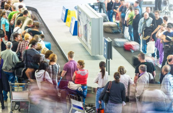 depositphotos_22223065-stock-photo-lots-of-getting-luggage-at